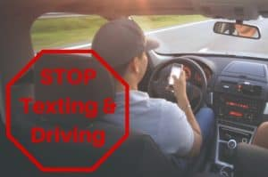 A distracted driver texting while driving